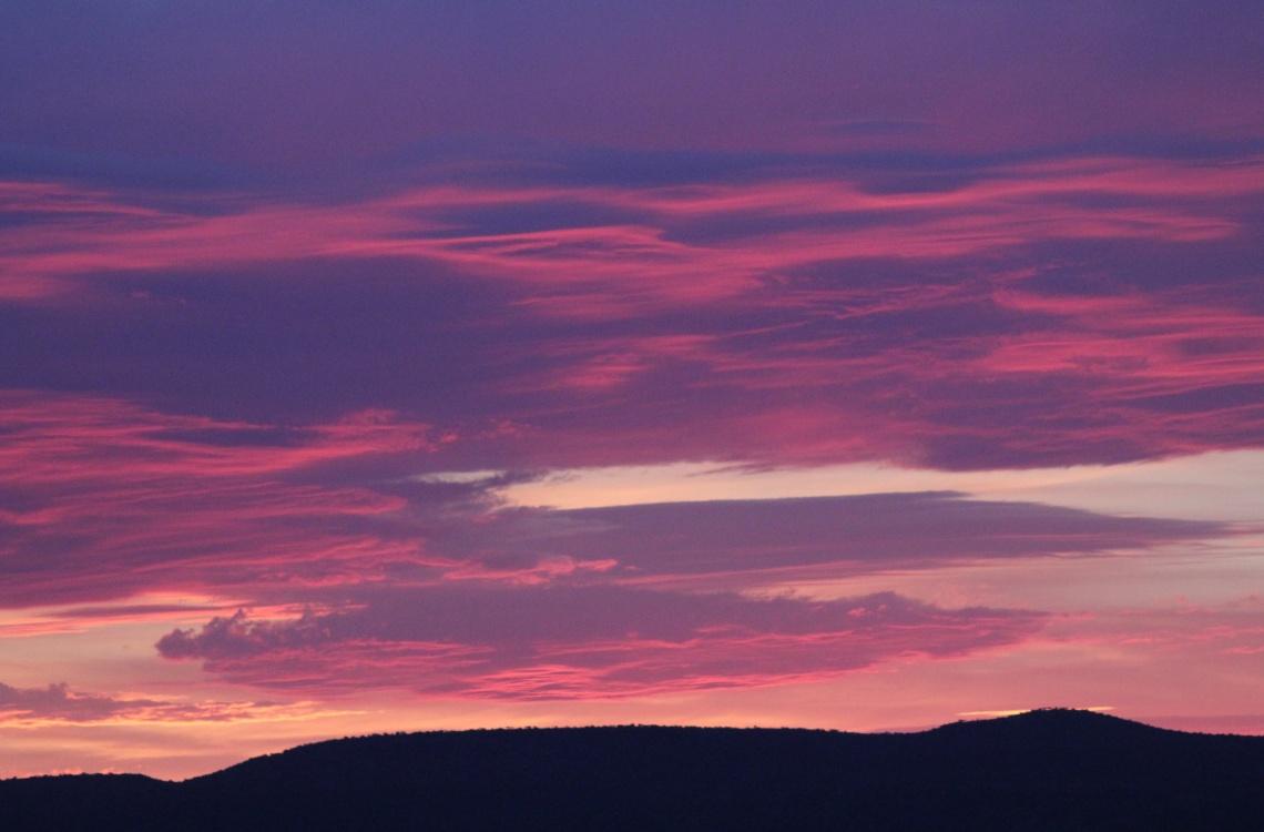Solnedgang over bjergene